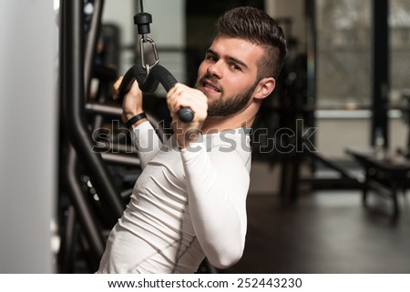 Young Man Doing Heavy Weight Exercise For Back In Gym - stock photo