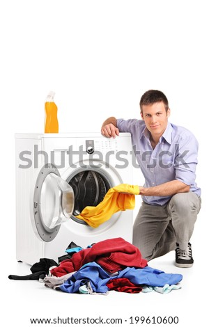 Young man doing laundry isolated on white background