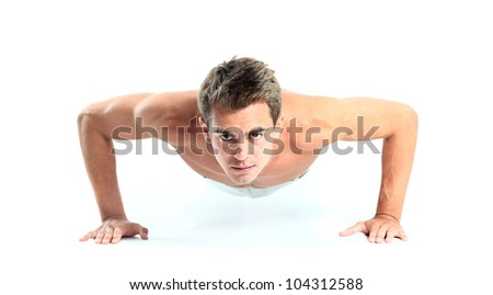 Young man doing push up exercise - stock photo