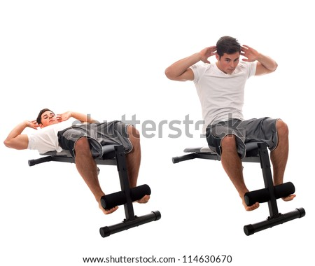 Young man doing sit-ups. Studio shot over white. - stock photo