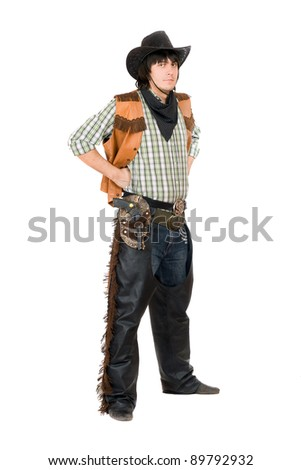 Young man dressed as cowboy. Isolated on white background - stock photo