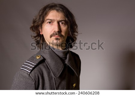 young man dressed as russian military - stock photo