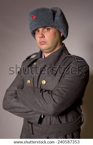 young man dressed as russian military, studio picture