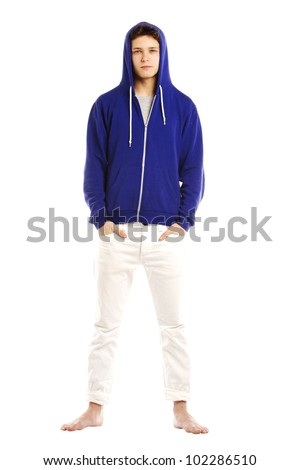 Young man dressed in hoodie and barefoot serious face - stock photo