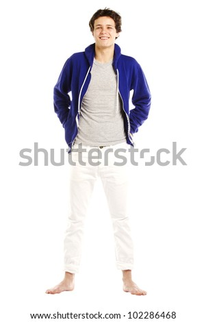 Young man dressed in hoodie and barefoot smiling - stock photo