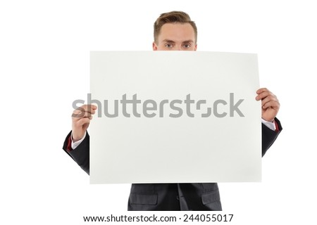 Young man dressed with suit holding white empty paper isolated on white background.