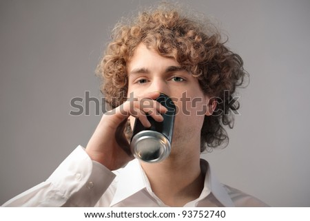 Young man drinking - stock photo