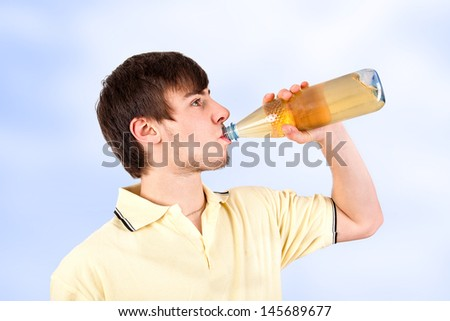Young man drinking from a bottle