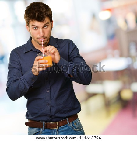 Young Man Drinking Juice, Indoor
