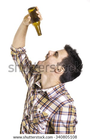young man drinking of empty beer bottle - stock photo