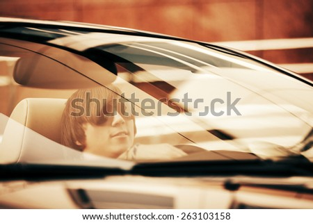 Young man driving convertible car