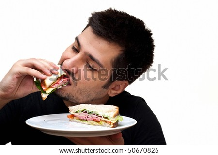 young man eating a sandwich isolated on white - stock photo