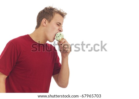 Young man eating ice cream cone
