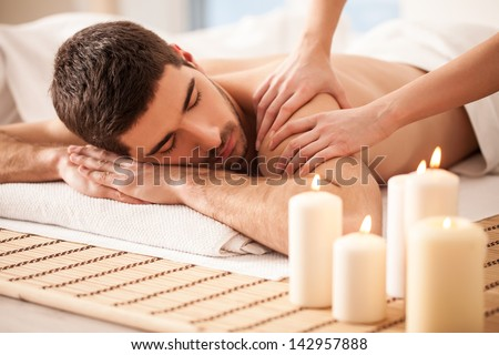 Young man enjoying a massage. - stock photo