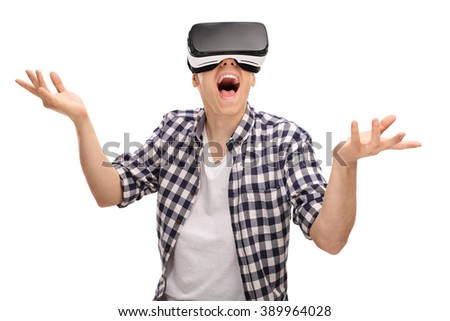 Young man enjoying a virtual reality experience isolated on white background