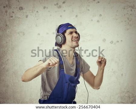 Young Man Enjoying Music. - stock photo