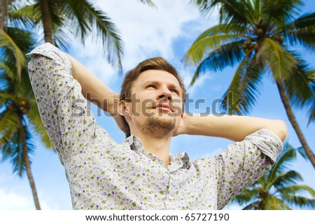 Young man enjoying tropical harmony - stock photo