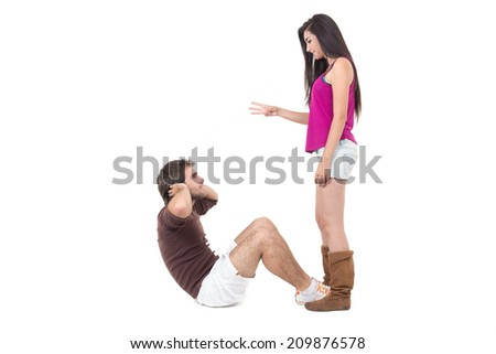 Young man excercising with beautiful personal trainer doing situps isolated on white - stock photo