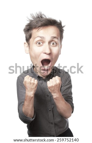 Young man excited and shows fista - stock photo