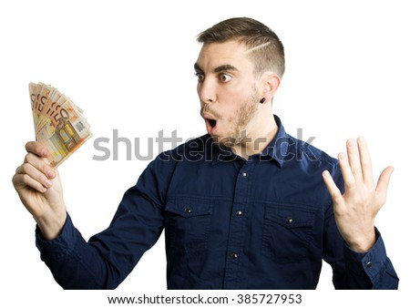 Young man excited holding fifty euro banknotes on the right hand