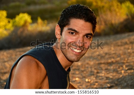 Young man exercising in outdoor environment.Physically Fir Man/Young man doing his exercises in an outdoor environment - stock photo