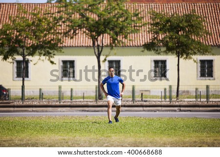 Young man exercising outdoor - stock photo