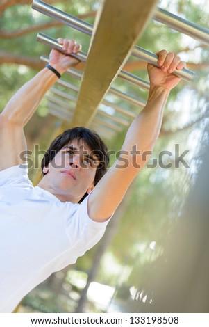 Young Man Exercising; Outdoors - stock photo