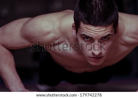 Young Man Exercising Push Ups
