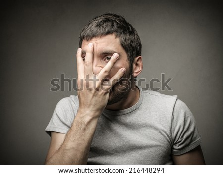 Young man feeling uneasy  - stock photo