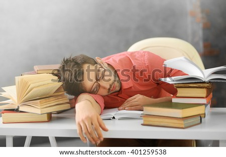 Young man fell asleep during reading. - stock photo