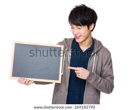 Young man finger point to chalkboard - stock photo