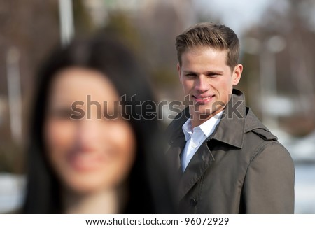 Young man flirting on the street