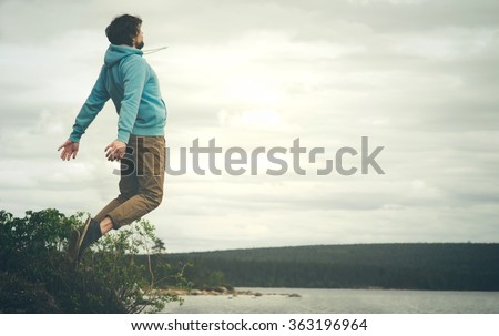 Young Man Flying levitation jumping outdoor relax Lifestyle Travel happiness spiritual concept moody colors - stock photo