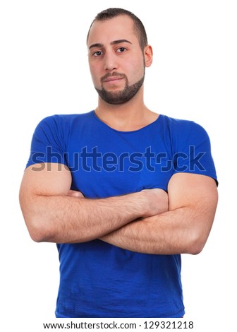 Young man folded arms confidently