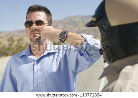 Young Man Forced To Take A Field Sobriety Test - stock photo