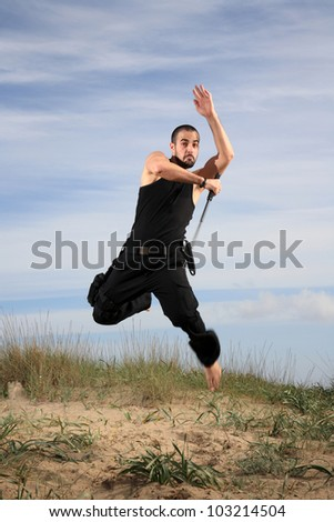young man from special forces exercising outdoor motion blur - stock photo