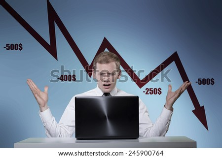Young man frustrated of stock market crisis - stock photo