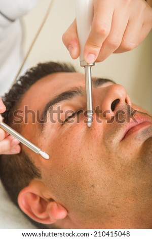 Young Man getting a face treatment