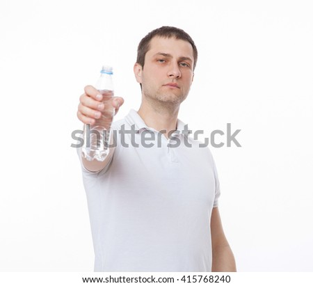 Young man giving a bottle of water, white background