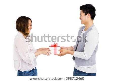 Young man giving a present to woman on white background - stock photo