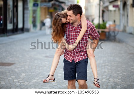 Young man giving piggyback ride to his girlfriend