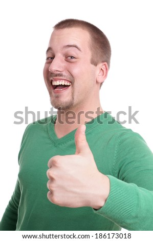 young man giving thumbs up - stock photo