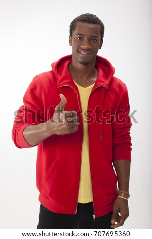 Young Man Giving Thumbs Up Gesture
