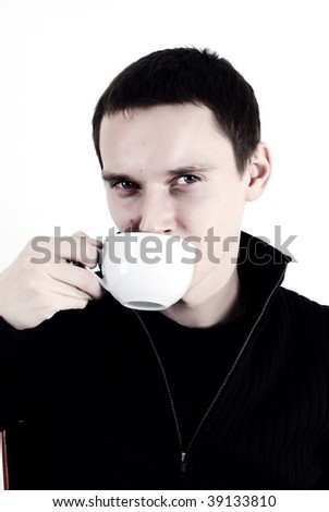 Young man giving us asian natural tea ceramic cup