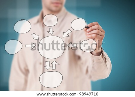 Young Man hand drawing flowchart - stock photo