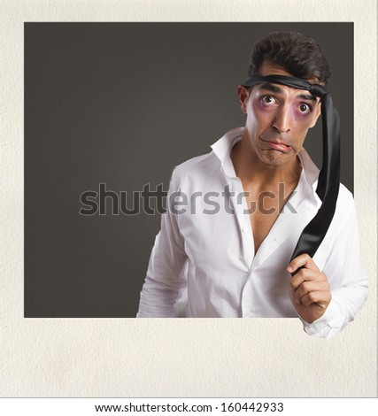 young man hangover gesture on photo frame
