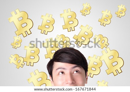 young man happy looking bitcoin, business and bitcoin concept - stock photo