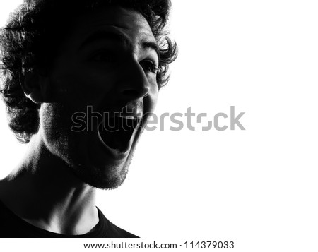 young man happy screaming silhouette in studio isolated on white background