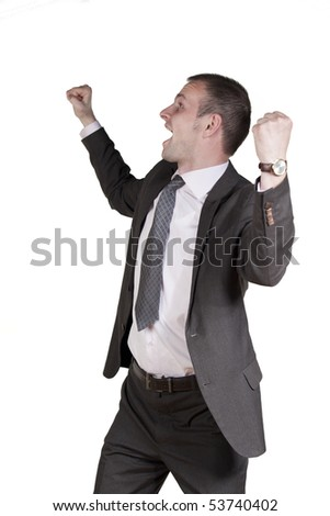 Young man happy with arms up - stock photo
