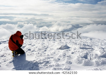young man has a rest in mountains